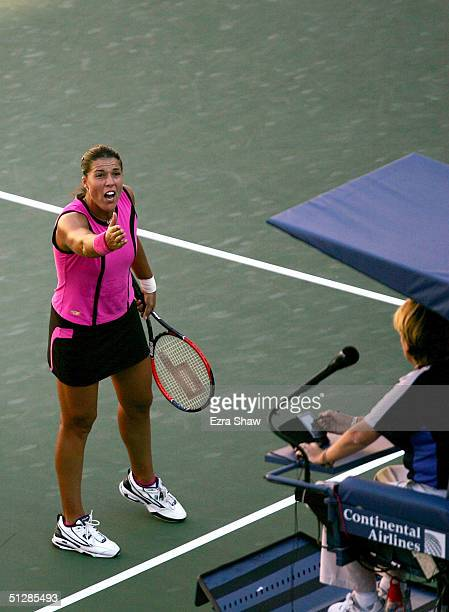 Jennifer Capriati argues a call against Elena Dementieva of Russia during the women's semifinal match at the US Open September 10 2004 at the USTA...