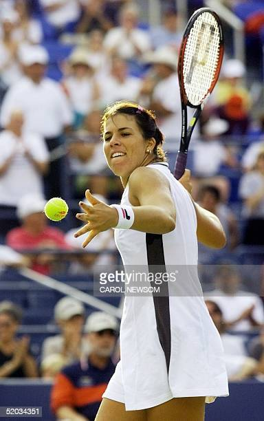 Jennifer Capriati of the US celebrates her victory over Seda Noorlander of the Netherlands by hitting balls to the crowd 02 September at the US Open...
