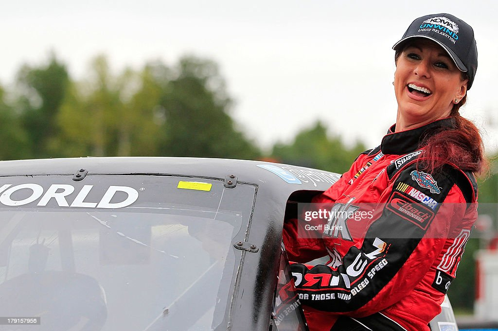Jennifer Cobb, driver of the #10 Koma Unwind RAM, climbs into her truck during qualifying for the NASCAR Camping World Truck Series Chevrolet Silverado 250 at Canadian Tire Motorsport Park on August 31, 2013 in Bowmanville, Canada.
