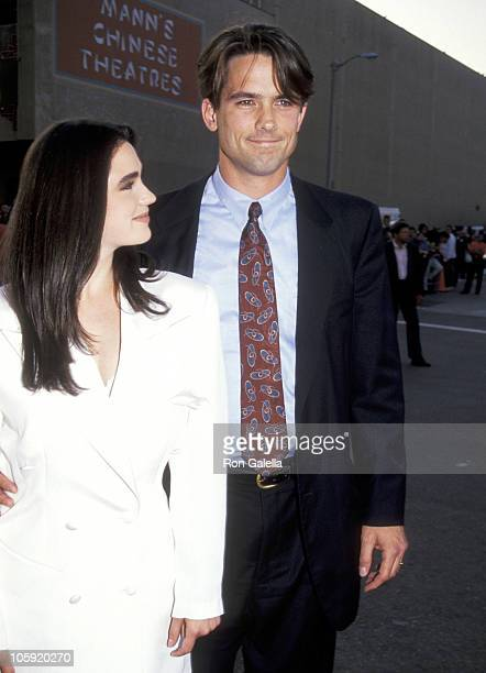 Jennifer Connelly and Billy Campbell during 'The Rocketeer' RibbonCutting Ceremony 1991 at El Capitan Theater in Hollywood California United States