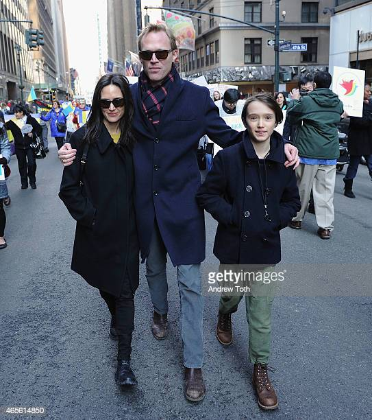 Jennifer Connelly Paul Bettany and Stellan Bettany participate in the 2015 International Women's Day March at Dag Hammarskjöld Plaza on March 8 2015...