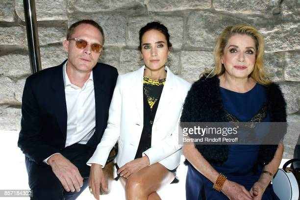 Jennifer Connelly sitting between her husband Paul Bettany and Catherine Deneuve attend the Louis Vuitton show as part of the Paris Fashion Week...