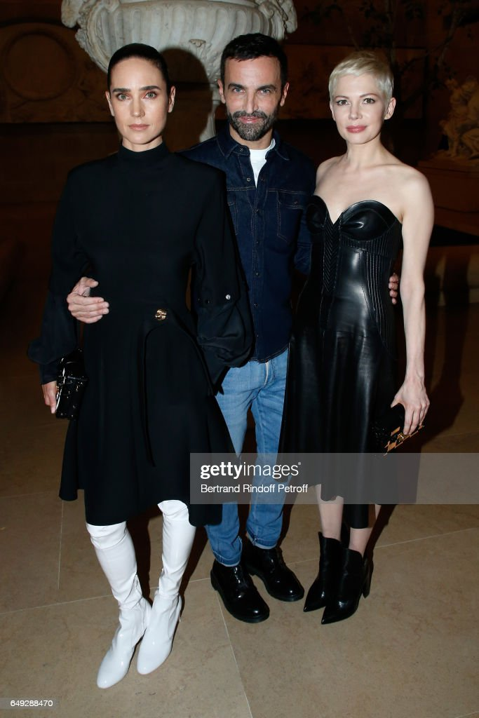 Jennifer Connelly, Stylist Nicolas Ghesquiere and Michelle Williams pose after the Louis Vuitton show as part of the Paris Fashion Week Womenswear Fall/Winter 2017/2018 on March 7, 2017 in Paris, France.