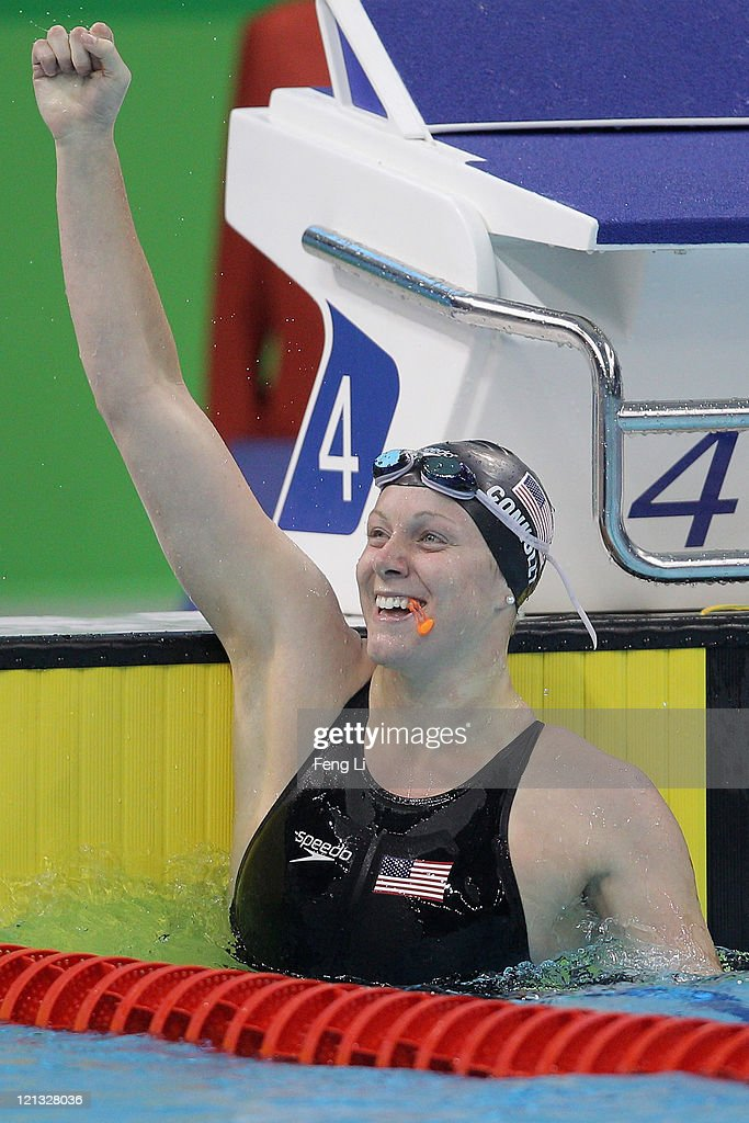 Jennifer Connolly of the United States celebrates winning the gold medal in Women's 50m Backstroke Final during Swimming Day Five of the 26th Summer...