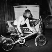 Jennifer ConstableMaxwell folding her collapsible bicycle into the trunk of her car 11th December 1963