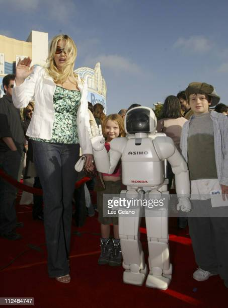 Jennifer Coolidge and Asimo during Honda's 'Asimo' Robot Walks the Red Carpet at the Premiere of 'Robots' at Mann Village Theater in Westwood...