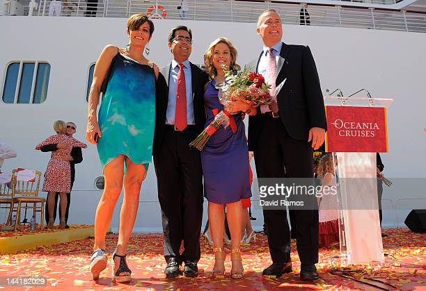 Jennifer Cora President of Oceania Cruises Kunal S Kamlani Godmother Cat Cora and President of Prestige Cruise Holdings Bob Binder pose for the...
