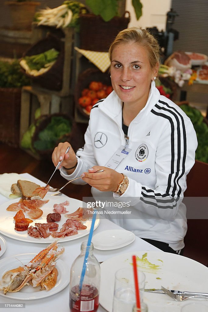 Jennifer Cramer looks on during the DFB Team & Sponsors Cooking Event on June 24, 2013 in Munich, Germany.