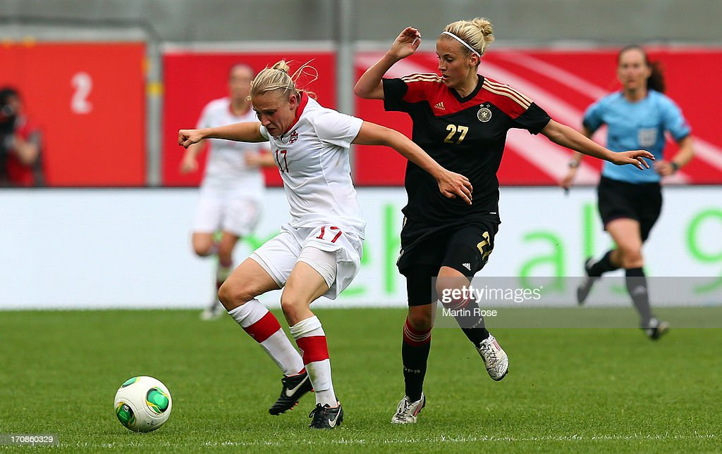 Jennifer Cramer (R) of Germany and Melissa Busque of Canada battle for the ball during the Women's International Friendly match between Germany and Canada at Benteler Arena on June 19, 2013 in Paderborn, Germany.