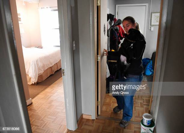 Jennifer DahirKanehl holds her lab mix puppy Ty coming out of her room directly across from her lockoff room left attached to the condo April 26 2017...