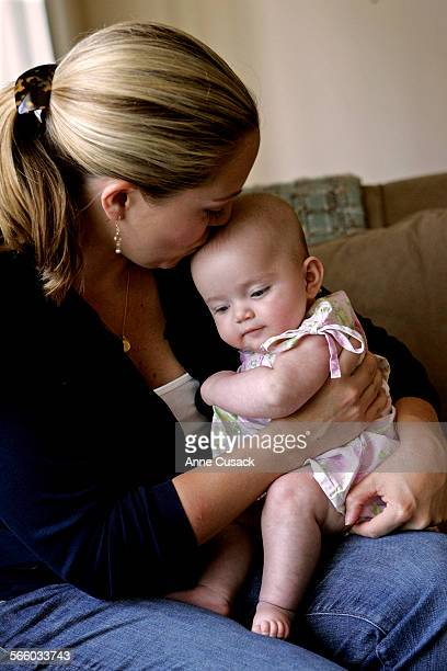 PASADENA CA – JULY 24 2008 Jennifer Danylyshyn kisses her four month old daughter Ava Danylyshyn at their Pasadena home on July 24 2008Ava has been...