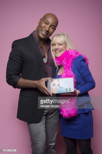 Jennifer Elise Cox gets a gift from Marc Harvey of 'Element 2 Beauty' at the Mark Kearney Group 'Iced Out' Luxury Emmy Suite on September 19 2013 in...