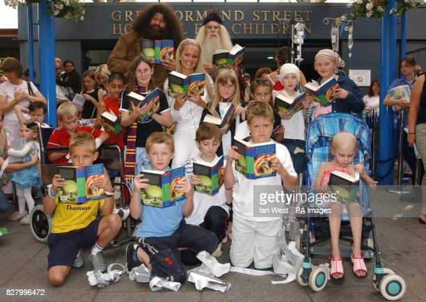 Jennifer Ellison Hagrid and Professor Dumbledore during a visit to hand out copies of the new Harry Potter book which was released at midnight