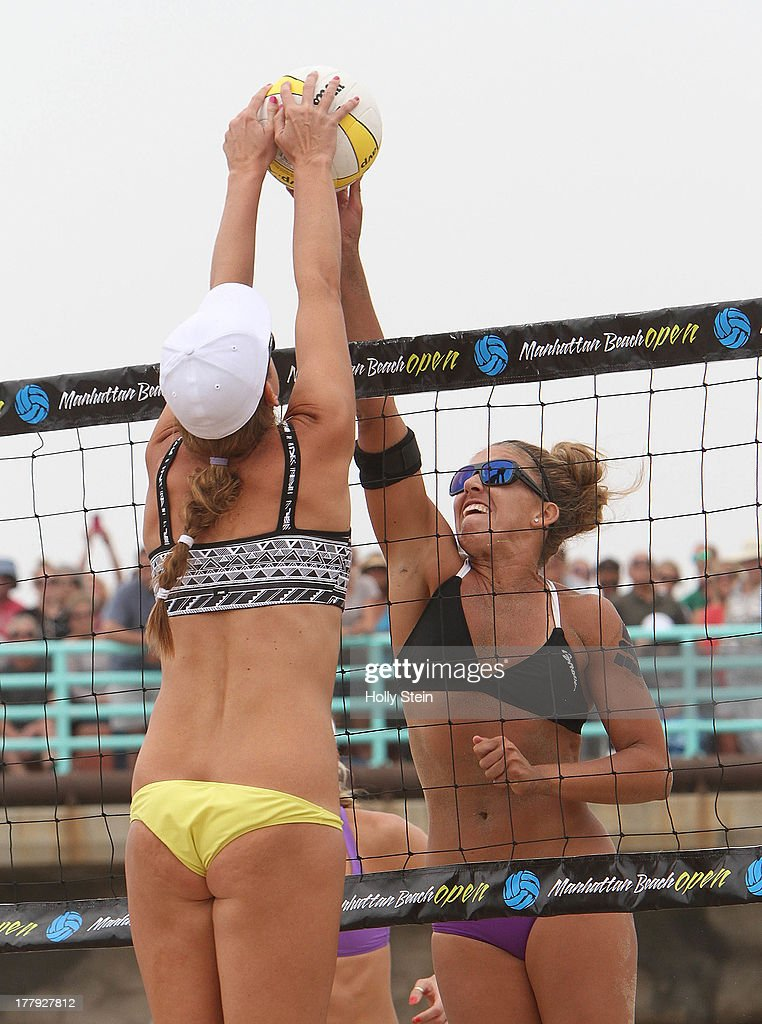 Jennifer Fopma (L) and Whitney Pavlik (R) joust at the net during the women's finas at the AVP Manhattan Beach Open on August 25, 2013 in Manhattan Beach, California. Pavlik and her parter Kerri Walsh Jennings defeated Jennifer Fopma and Brooke Sweat 22-20, 21-17.