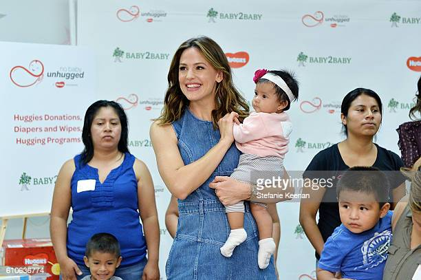 Jennifer Garner kicks off Diaper Need Awareness Week by accepting a Huggies No Baby Unhugged donation of 25 million diapers and 5 million wipes to...