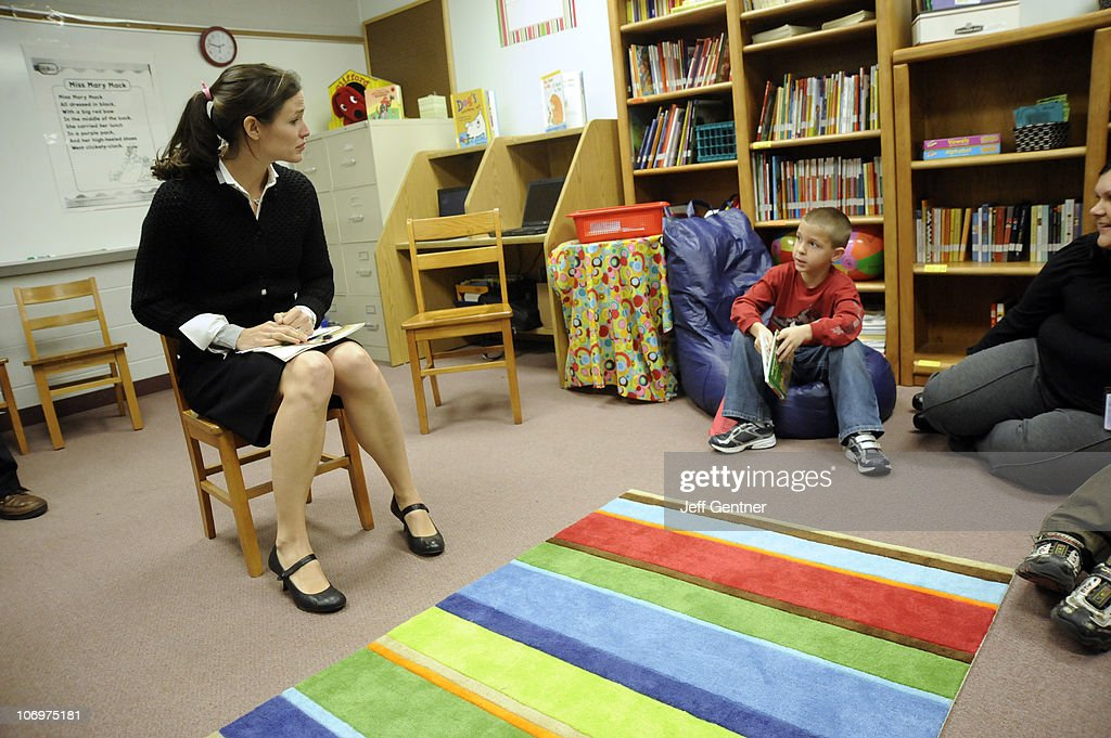 Jennifer Garner works with students during the launch of six new Save the Children US Program sites at the Ashton Elementary School on November 19...