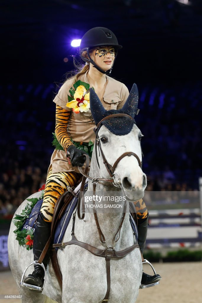 US Jennifer Gates, daughter of Bill Gates, competes during the Style and Competition for Amade charity costumed event of the Paris Masters equestrian jumping competition on December 7, 2013 at the Parc des Expositions in Villepinte, north of Paris.
