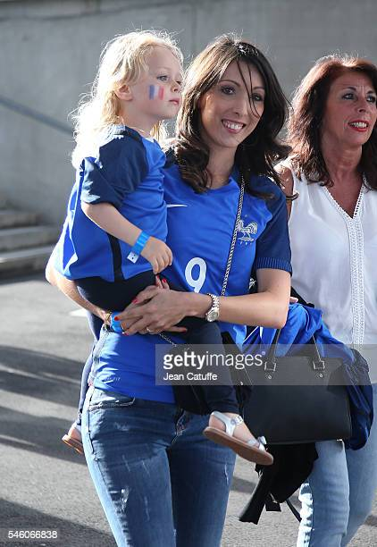 Jennifer Giroud and daughter Jade Giroud attend the UEFA Euro 2016 final match between Portugal and France at Stade de France on July 10 2016 in...