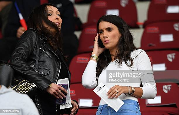 Jennifer Giroud wife of France's forward Olivier Giroud and Ludivine Sagna wife of France's defender Bacary Sagna arrive for the friendly football...