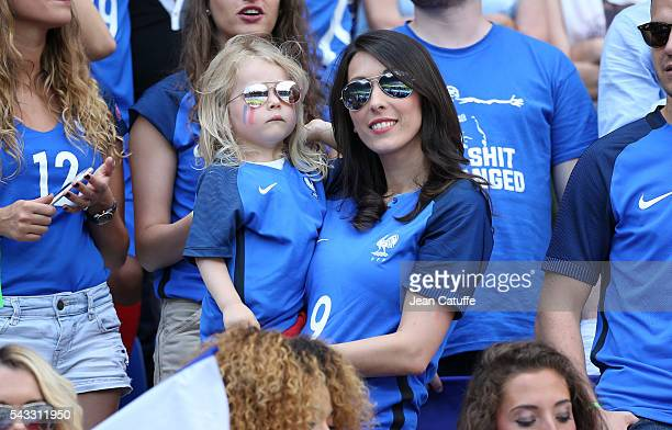 Jennifer Giroud wife of Olivier Giroud holds their daughter Jade Giroud during the UEFA EURO 2016 round of 16 match between France and Republic of...