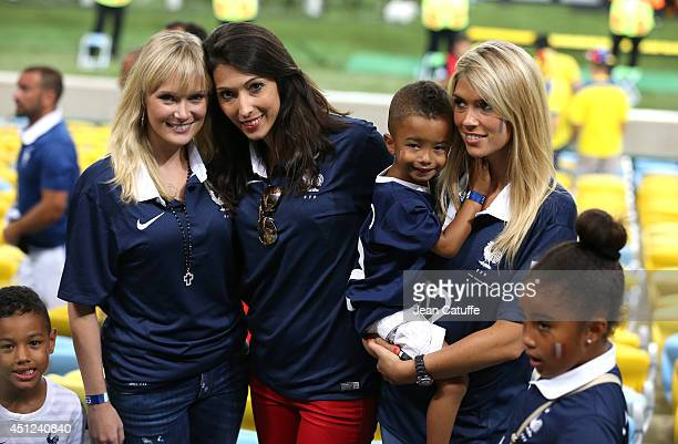 Jennifer Giroud wife of Olivier Giroud of France and Elodie Mavuba wife of Rio Mavuba of France with her children Tiago and Uma pose for a picture...