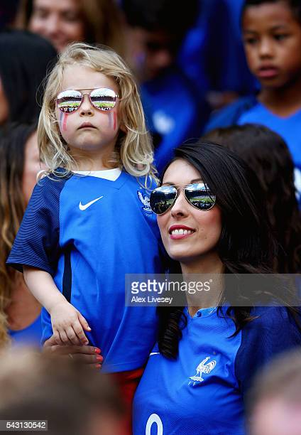 Jennifer Giroud wife of Olivier Giroud of France holding her daughter Jade is seen in the stand prior to the UEFA EURO 2016 round of 16 match between...