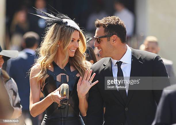 Jennifer Hawkins and Jake Wall arrive at the Myer marquee on Victoria Derby Day at Flemington Racecourse on November 2 2013 in Melbourne Australia