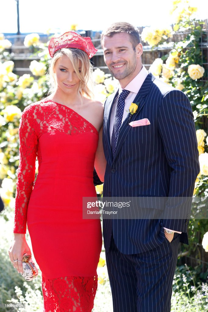Jennifer Hawkins and Kris Smith pose for photos during Melbourne Cup Day at Flemington Racecourse on November 5, 2013 in Melbourne, Australia.