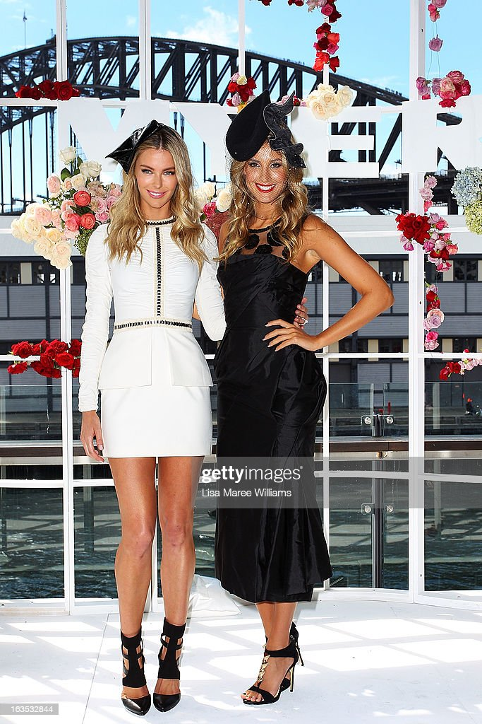 Jennifer Hawkins and Laura Dundovic pose at the Myer Autumn/Winter Collection preview at The Bar at the End of the Wharf on March 12, 2013 in Sydney, Australia.