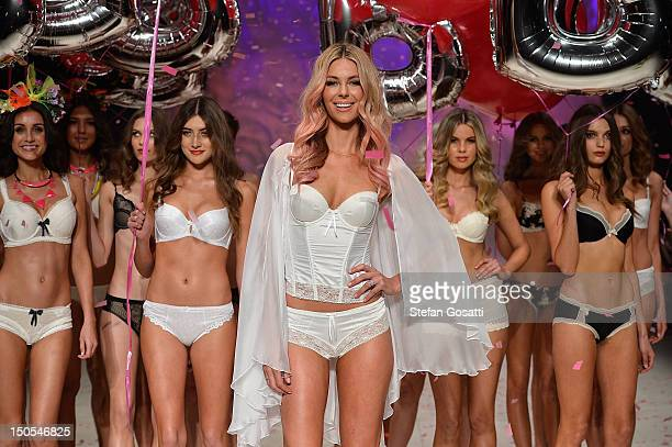 Jennifer Hawkins and models showcase designs by Bendon on the catwalk as part of the Mercedes Benz Fashion Festival Sydney 2012 at Sydney Town Hall...