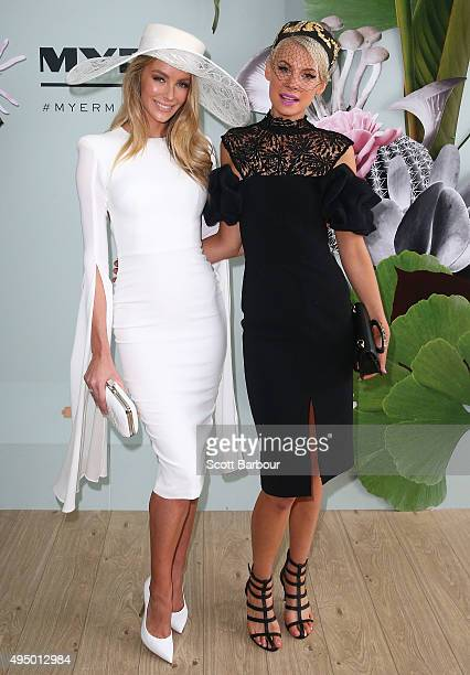 Jennifer Hawkins wearing Alex Perry and millinery by Ann Shoebridge and Kate Peck wearing White Suede and millinery by Phillip Rhodes pose at the...