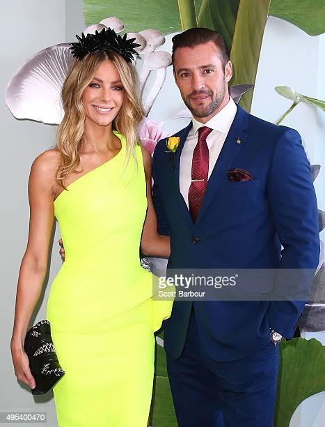 Jennifer Hawkins wearing Maticevski and millinery by Natalie Bikicki and Kris Smith wearing Wolf Kanat pose at the Myer Marquee on Melbourne Cup Day...