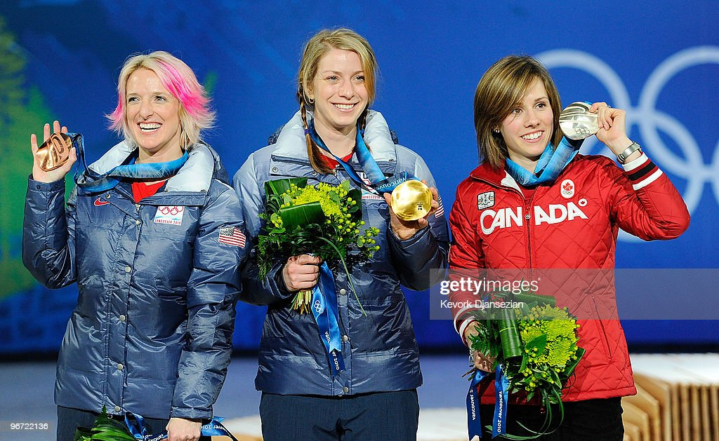<a gi-track='captionPersonalityLinkClicked' href=/galleries/search?phrase=Jennifer+Heil&family=editorial&specificpeople=820250 ng-click='$event.stopPropagation()'>Jennifer Heil</a> of Canada celebrates silver, <a gi-track='captionPersonalityLinkClicked' href=/galleries/search?phrase=Hannah+Kearney&family=editorial&specificpeople=228988 ng-click='$event.stopPropagation()'>Hannah Kearney</a> of United States celebrates gold and <a gi-track='captionPersonalityLinkClicked' href=/galleries/search?phrase=Shannon+Bahrke&family=editorial&specificpeople=770199 ng-click='$event.stopPropagation()'>Shannon Bahrke</a> of United States celebrates bronze during the medal ceremony for the Ladies Moguls final Medal ceremony on day 3 of the Vancouver 2010 Winter Olympics at BC Place on February 14, 2010 in Vancouver, Canada.