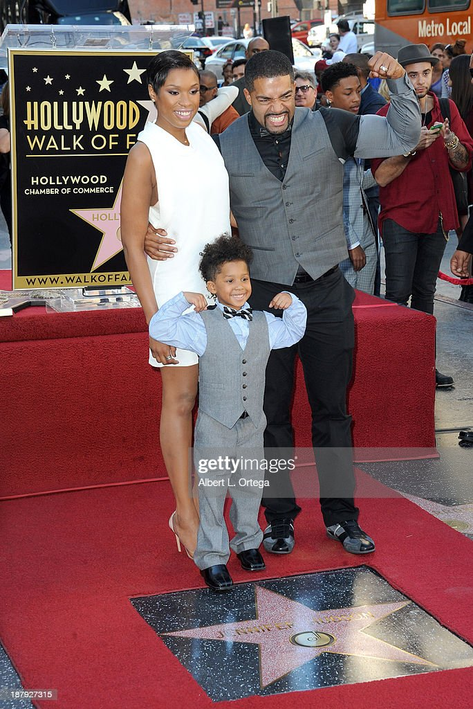 <a gi-track='captionPersonalityLinkClicked' href=/galleries/search?phrase=Jennifer+Hudson&family=editorial&specificpeople=234833 ng-click='$event.stopPropagation()'>Jennifer Hudson</a> poses with David Daniel Otunga Sr. and David Daniel Otunga Jr. as she is honored on The Hollywood Walk of Fame on November 13, 2013 in Hollywood, California.