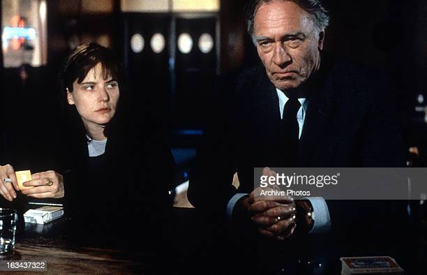 Jennifer Jason Leigh at bar counter with Christopher Plummer in a scene from the film 'Dolores Claiborne' 1995