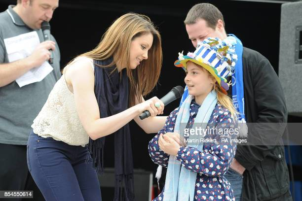 Jennifer Jewell talks to an Everton fan in her home made Easter Bonnet