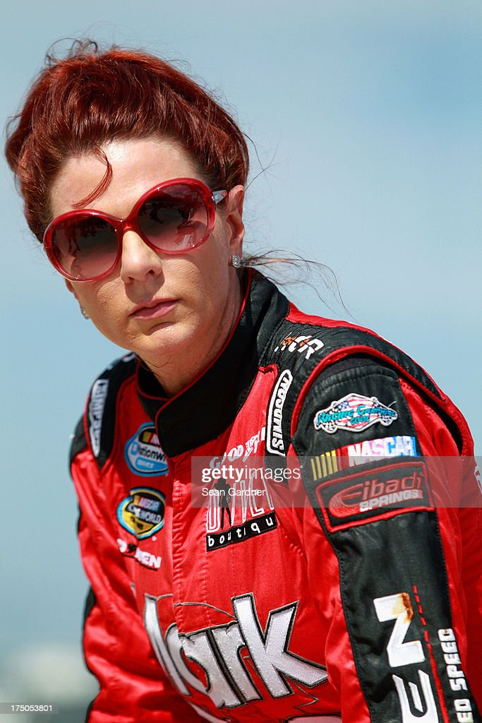 Jennifer Jo Cobb, driver of the #10 Koma Unwind Relaxation Drink RAM, waits by the track during qualifying for the NASCAR Camping World Truck Series UNOH 225 at Kentucky Speedway on June 27, 2013 in Sparta, Kentucky.
