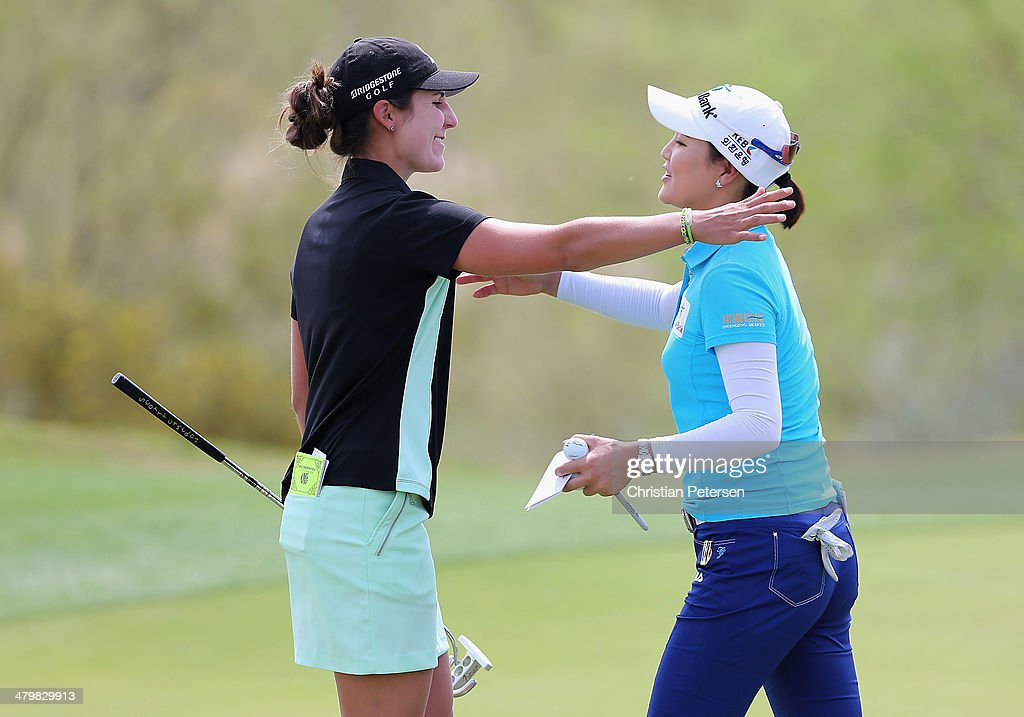Jennifer Johnson hugs Ryu So Yeon of South Korea on the 18th green following the first round of the JTBC LPGA Founders Cup at Wildfire Golf Club on March 20, 2014 in Phoenix, Arizona.