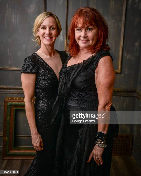 Jennifer Jones and Mary Walsh pose in the 2017 Biblio Bash Portrait Studio at the Toronto Reference Library on April 27 2017 in Toronto Canada