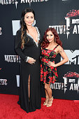 Jennifer 'JWoww' Farley and Nicole 'Snooki' Polizzi attend the 2014 MTV Movie Awards at Nokia Theatre LA Live on April 13 2014 in Los Angeles...