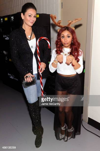 Jennifer 'JWoww' Farley and Nicole 'Snooki' Polizzi pose backstage at Z100's Jingle Ball 2013 presented by Aeropostale at Madison Square Garden on...