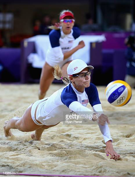 Jennifer Kessy of the United States dives for the ball as April Ross of the United States looks on during the Women's Beach Volleyball Quarter Final...