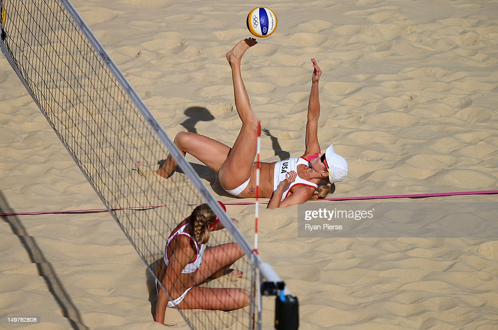Jennifer Kessy of the United States kicks the ball over the net as April Ross of the United States looks on during the Women's Beach Volleyball Round of 16 match between United States and Switzerland on Day 7 of the London 2012 Olympic Games at Horse Guards Parade on August 3, 2012 in London, England.