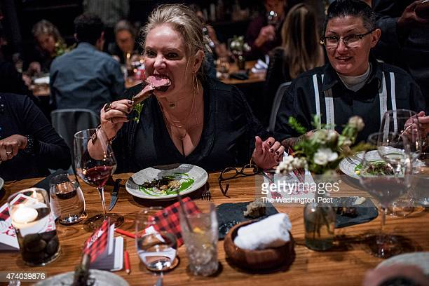 Jennifer KileournStevens and Kat Stevens eat pork chops at Chef David Barzelay's Lazy Bear Restaurant where an open kitchen and communal tables with...
