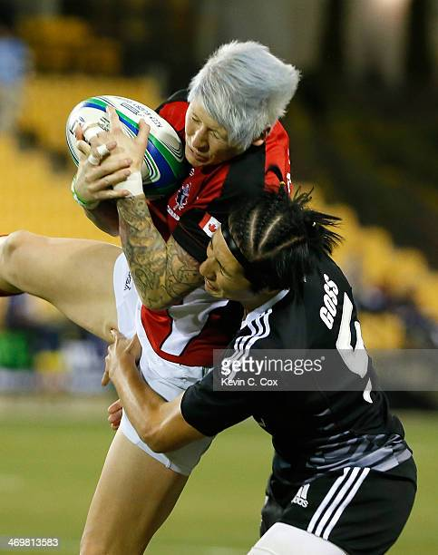 Jennifer Kish of Canada catches a kickoff against Sarah Goss of New Zealand during the Women's Sevens World Series at Fifth Third Bank Stadium on...