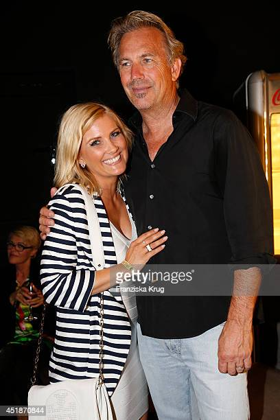 Jennifer Knaeble and Kevin Costner attend the Arqueonautas Presents Kevin Costner Music Meets Fashion at Spindler Klatt on July 08 2014 in Berlin...