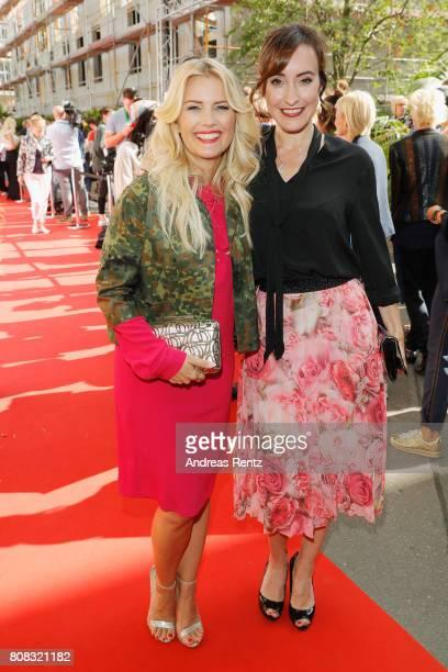 Jennifer Knaeble and Maike von Bremen attend the Riani Fashion Show Spring/Summer 2018 at Umspannwerk Kreuzberg on July 4 2017 in Berlin Germany