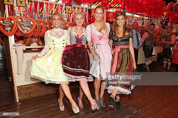 Jennifer Knaeble Barbara Sturm Monica Ivancan and Cathy Hummels attend the Regines Sixt Damen Wiesn during the Oktoberfest 2015 on September 21 2015...