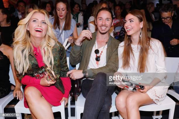 Jennifer Knaeble Gil Ofarim and Ekaterina Leonova attend the Riani Fashion Show Spring/Summer 2018 at Umspannwerk Kreuzberg on July 4 2017 in Berlin...