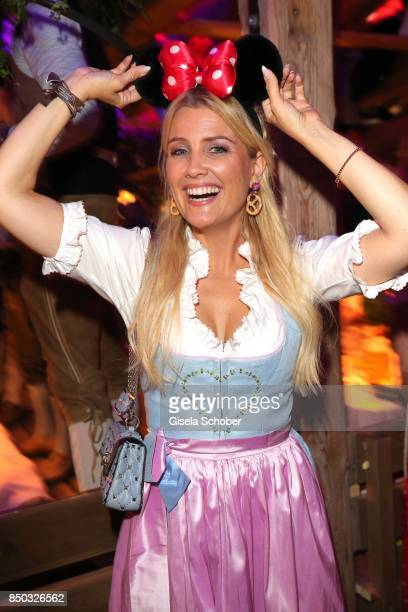 Jennifer Knaeble wearing Minnie Mouse ears during the 'Blond Wies'n' as part of the Oktoberfest at Theresienwiese on September 20 2017 in Munich...